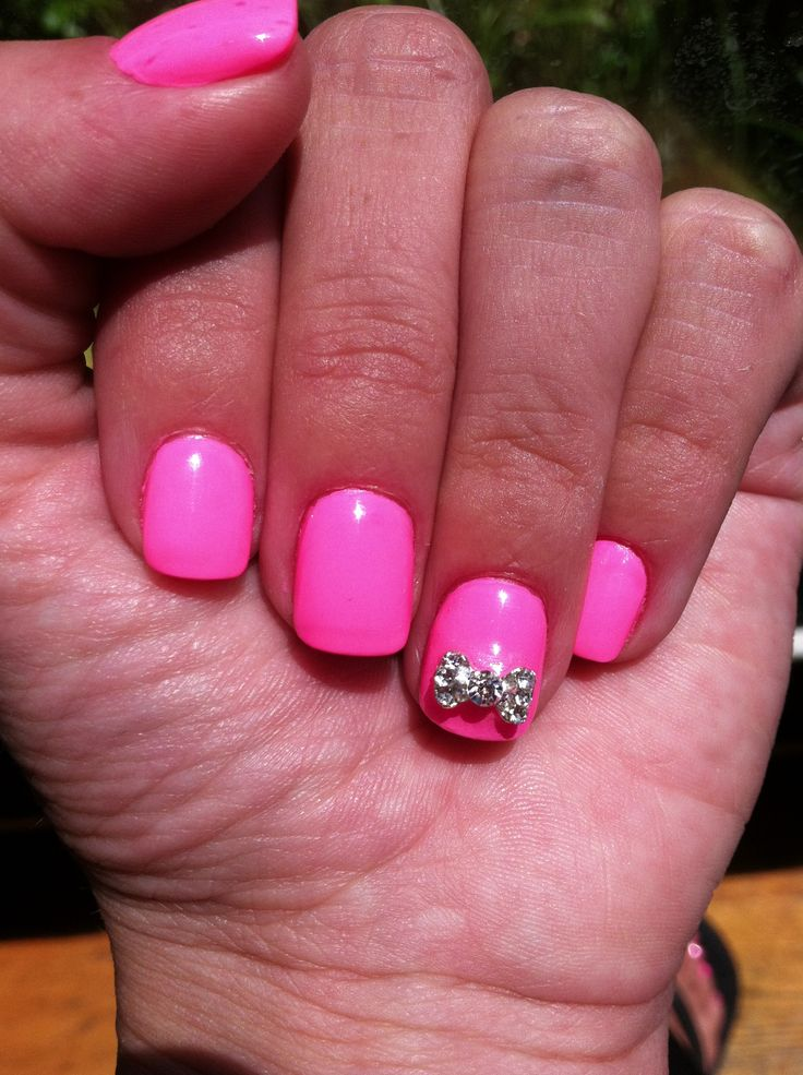 Pink nails with a cute bow