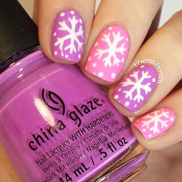 pink winter snowflake nail design