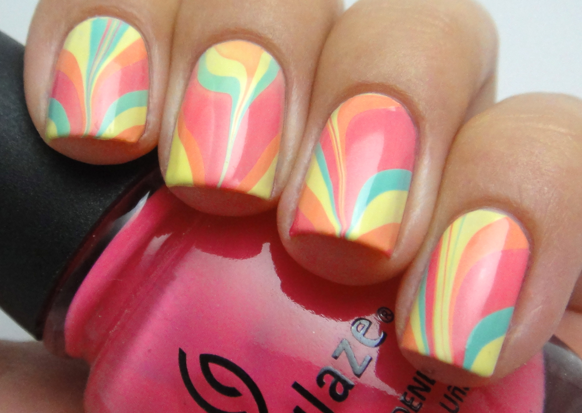 How To Get Water Marble Nail Art At Home Stylecaster Water Nail Art
